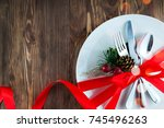 christmas table place setting... | Shutterstock . vector #745496263