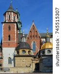 Small photo of KRAKOW POLAND 09 14 17: Royal Archcathedral Basilica of Saints Stanislaus and Wenceslaus on the Wawel Hill castle residency. Built at the behest of King Casimir III the Great.