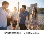 young man dancing with friends...   Shutterstock . vector #745522213