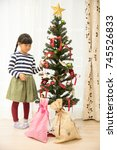 christmas tree and child | Shutterstock . vector #745526833