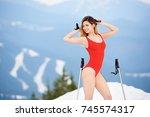 cheerful female skier wearing... | Shutterstock . vector #745574317