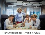 angry female boss yelling to... | Shutterstock . vector #745577233