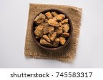 jaggery or gur with sugar cane... | Shutterstock . vector #745583317