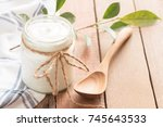 yogurt in glass bottles on... | Shutterstock . vector #745643533