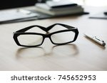 eyeglasses  pen and notebook on ... | Shutterstock . vector #745652953