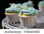 blue cupcake on cakestand... | Shutterstock . vector #745665403