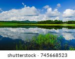 small lake with blue sky... | Shutterstock . vector #745668523