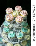 white cupcake   pink cupcake... | Shutterstock . vector #745674127
