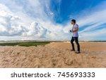 young asian traveler taking... | Shutterstock . vector #745693333