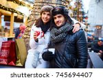 young couple doing christmas... | Shutterstock . vector #745694407
