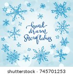 hand drawn snowflakes and stars ... | Shutterstock .eps vector #745701253