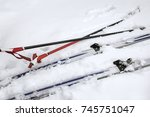 Ski Poles And Skis With...