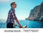 young man enjoys the seaside... | Shutterstock . vector #745773037