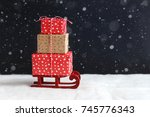 christmas gifts on small sledge