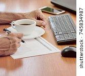 closeup of businessman working | Shutterstock . vector #745834987