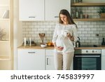 a young attractive pregnant... | Shutterstock . vector #745839997