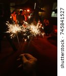 Small photo of Daventry, Northamptonshire, England - October 2017: Sparklers being held alight at a wedding reception