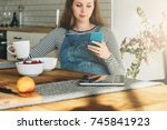 a young pregnant woman is... | Shutterstock . vector #745841923
