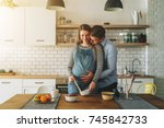 young married couple embraces... | Shutterstock . vector #745842733