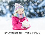 child playing with snow in... | Shutterstock . vector #745844473