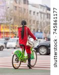 Small photo of YIWU-CHINA-JAN. 8, 2016. Chinese women on a rental bike in city center. With the bike-sharing boom still in its first decade, Asia is already outpacing European towns that started the phenomenon.