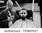 barbershop theme. bald barber... | Shutterstock . vector #745869427