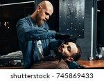 barbershop theme. bald bearded... | Shutterstock . vector #745869433
