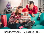 family at home sitting on the... | Shutterstock . vector #745885183