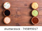 set of sauces in bowl on wooden ... | Shutterstock . vector #745895017