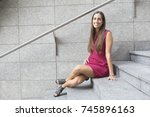 young city girl sitting on a... | Shutterstock . vector #745896163