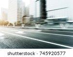blurry traffic on road in... | Shutterstock . vector #745920577