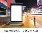 blank billboard on street in... | Shutterstock . vector #745921663