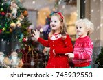 kids shopping for christmas... | Shutterstock . vector #745932553