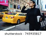 serious businesswoman in black... | Shutterstock . vector #745935817