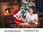 mother and daughter baking... | Shutterstock . vector #745945753