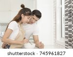 portrait of young asian couple... | Shutterstock . vector #745961827