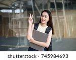 portrait of cute asian teen ... | Shutterstock . vector #745984693