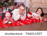 friendly family on a red plaid... | Shutterstock . vector #746011507