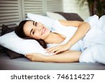 young smiling brunette woman... | Shutterstock . vector #746114227