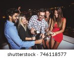 group of people having a party... | Shutterstock . vector #746118577