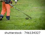 a man with a lawnmower on... | Shutterstock . vector #746134327