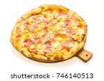 hawaiian pizza on wooden tray... | Shutterstock . vector #746140513