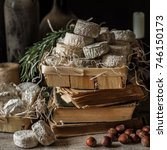 Small photo of Variety of French Cheeses and Another Provision in a Dusty Pantry, square