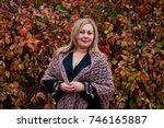 portrait of a beautiful plus... | Shutterstock . vector #746165887