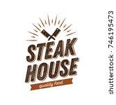 steak house logo with crossed... | Shutterstock .eps vector #746195473