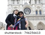 Small photo of PARIS, FRANCE - SEPTEMBER 6 : Asain women mother and daughter travel and posing for take photo with Cathedrale Notre-Dame de Parison September 6, 2017 in Paris, France