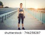 full length portrait of sporty... | Shutterstock . vector #746258287
