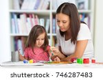 mother and daughter together... | Shutterstock . vector #746287483