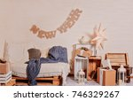 a room with a sofa decorated... | Shutterstock . vector #746329267