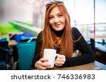 beautiful girl drinking coffee... | Shutterstock . vector #746336983